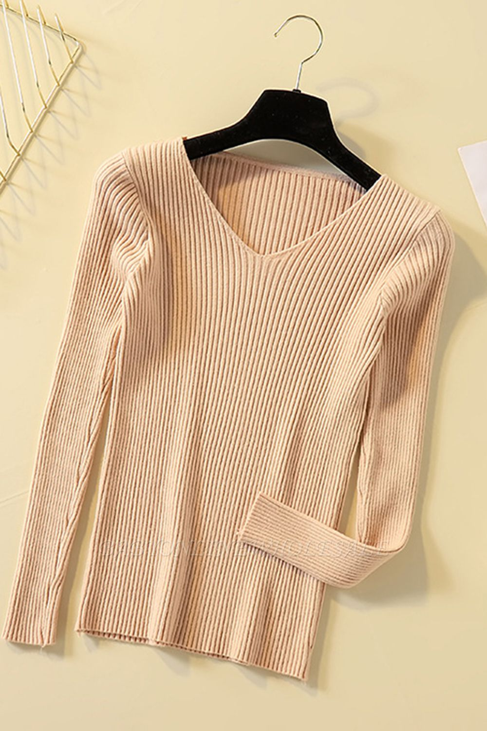 Soft V-neck fitted knit sweater with dropped shoulders with ribbing at cuffs and hem