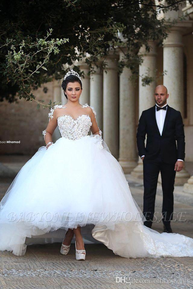 Élégante robe de mariée blanche en tulle à manches longues en tulle