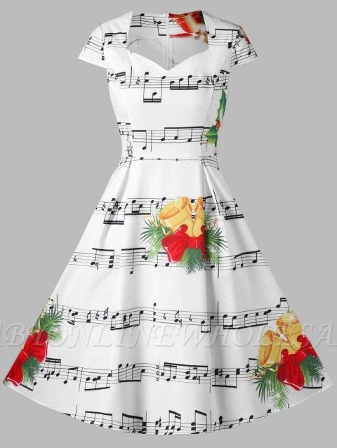 Cloche de Noël et robe imprimée note de musique