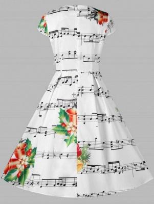 Cloche de Noël et robe imprimée note de musique_3